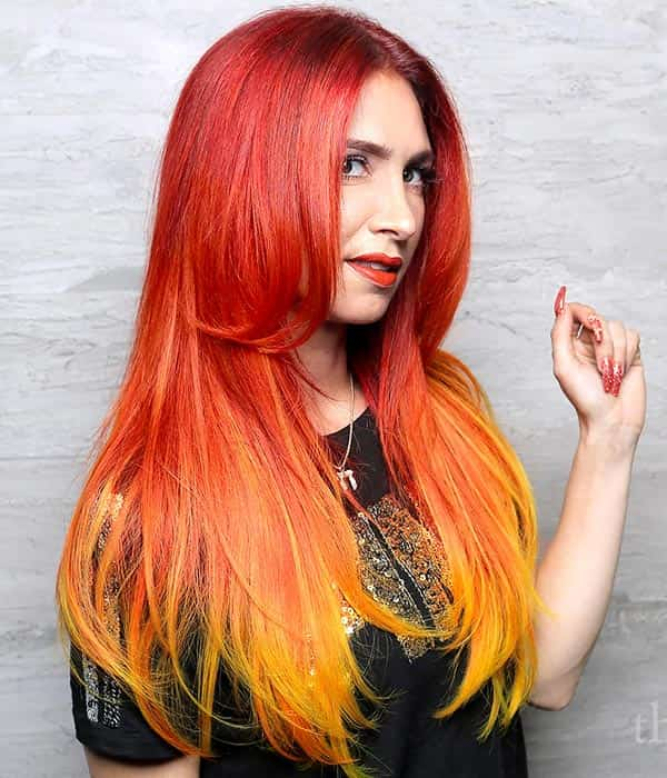 Girl with hair that looks like fire shifting from red to orange.