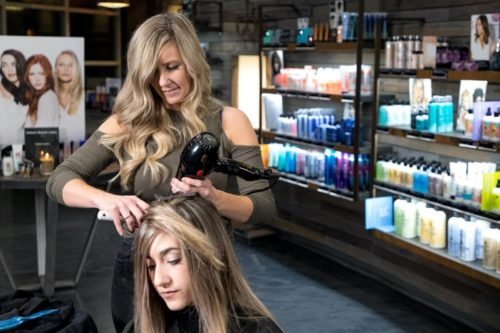 The Hair Standard stylist Amy Carmody doing a Babylights Balayage Service with Bumble and bumble products in background