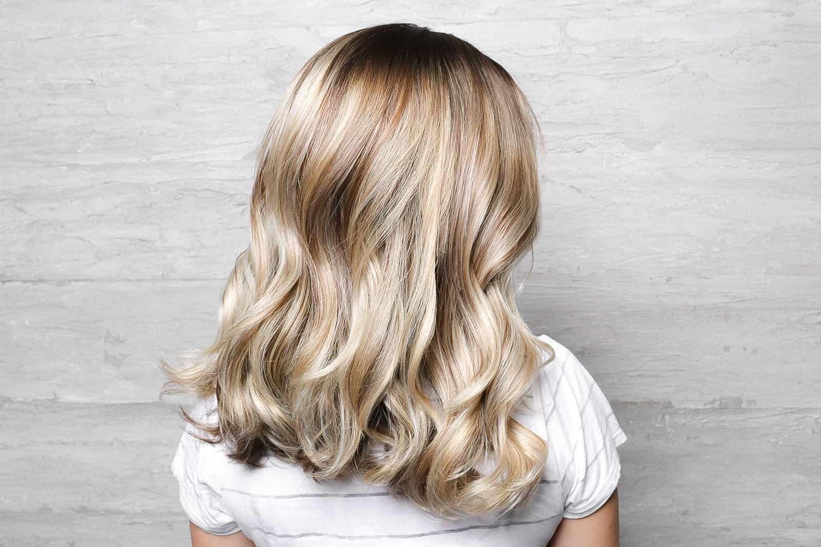 Blonde balayage with blow out curls