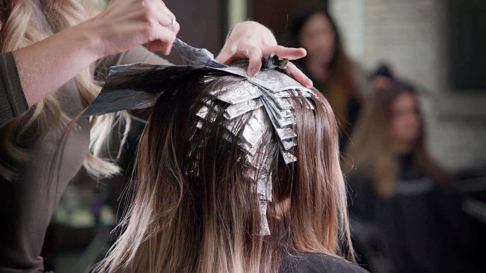 Small sections of hair put into foils for a babylights balayage technique.