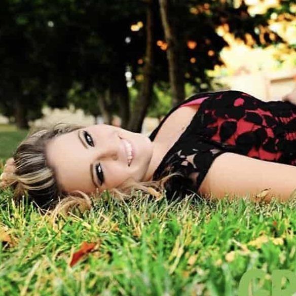 Taylor Doughtery The Hair Standard Las Vegas laying on grass